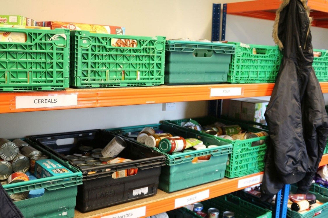Foodbank shelving including cereals, jars and cans of food